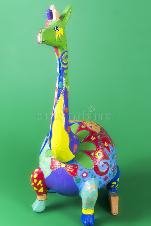 Handicraft, craftwork, workmanship, giraffe, camelopard, colorful, colourful, colored, green background. Handicraft craftwork workmanship giraffe camelopard royalty free stock image