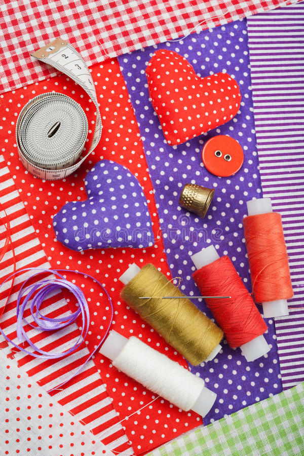 Handicraft hearts, fabric materials and items for sewing. Handicraft hearts, textile fabric materials and items for sewing stock image