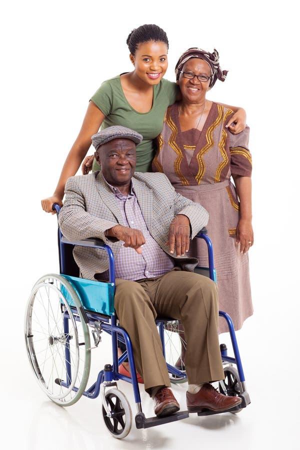Handikappad afrikansk manfrudotter arkivfoto