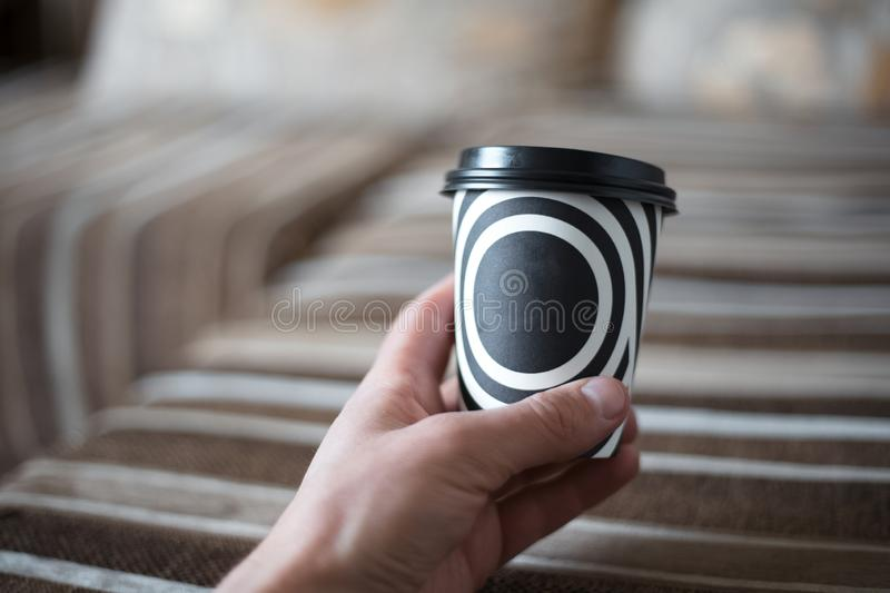 Handing a black and white cup of coffee. Handing a black and white cup of coffee stock photos