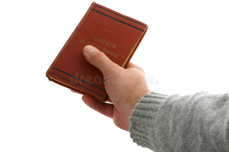 Handing over a book to a new chairperson royalty free stock image