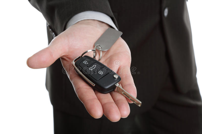 Handing over the car key stock image