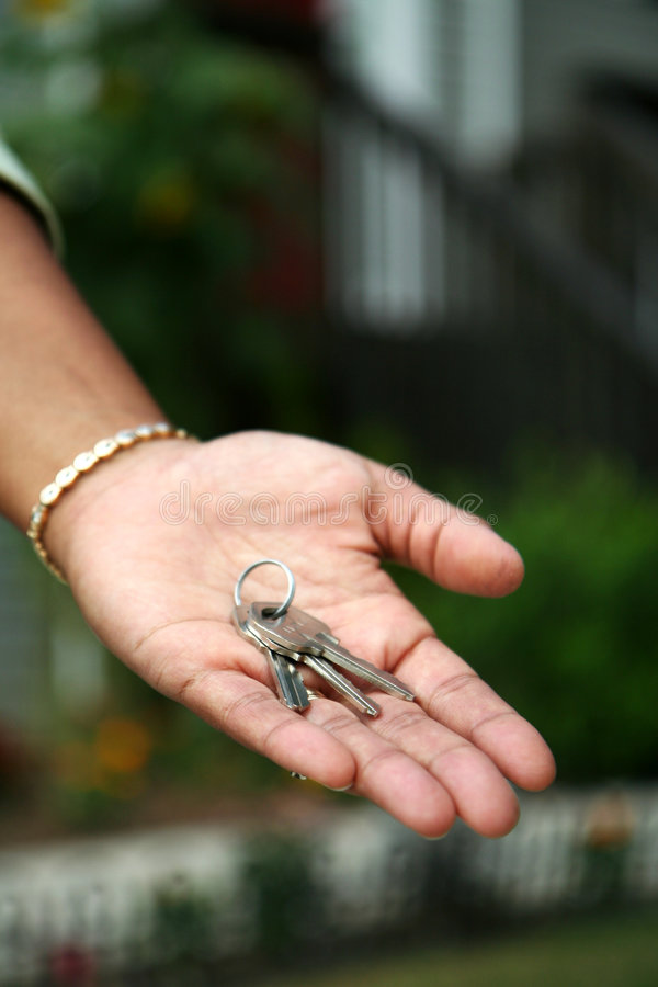 Download Handing Over the Keys stock image. Image of hispanic, apartment - 1221813