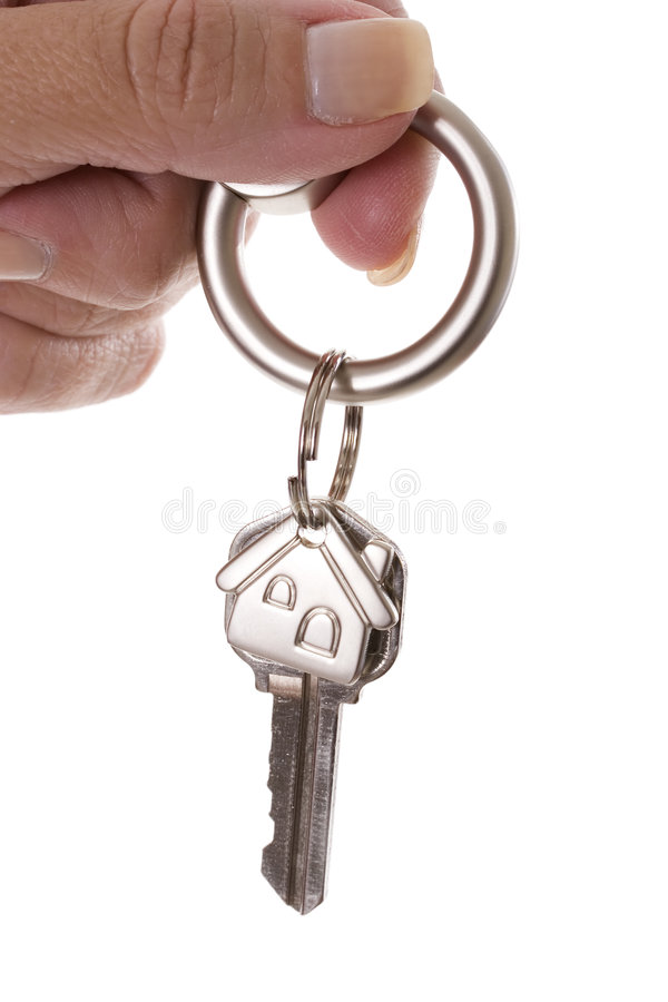 Handing over the keys. Woman holding a key for a house on a keychain stock image
