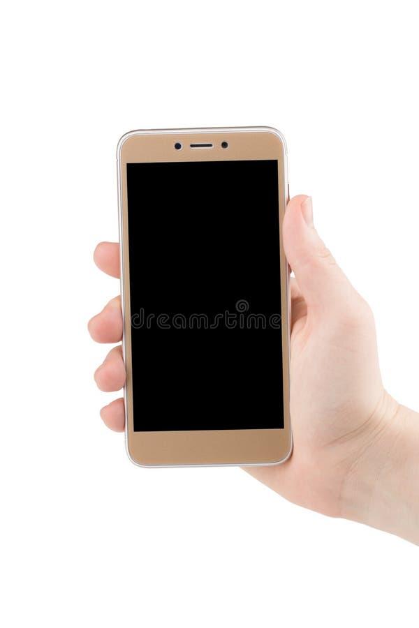 Handinnehavtelefon som inom isoleras på den vita snabba banan royaltyfri fotografi