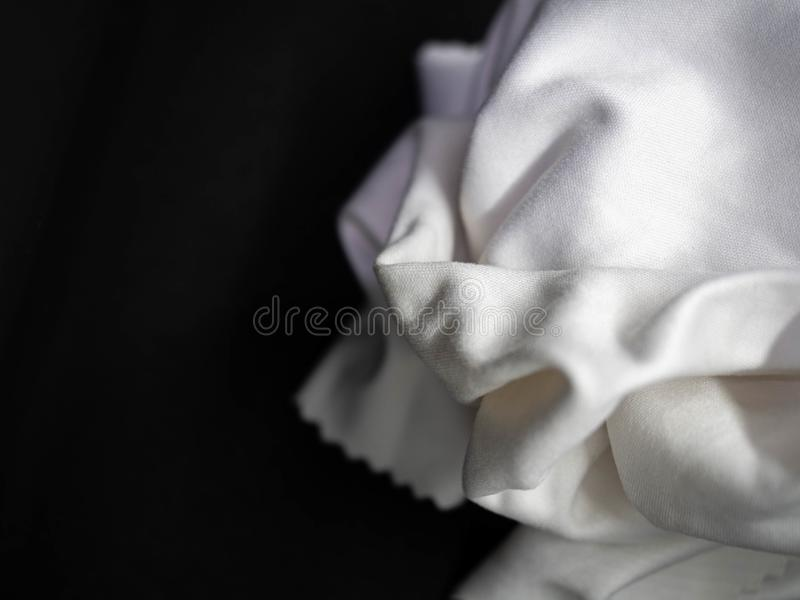Handkerchief Texture,Cleaning,Fold the pile,White,Black background,Closeup. Handkerchief Texture Cleaning Fold the pile White Black background Closeup stock image