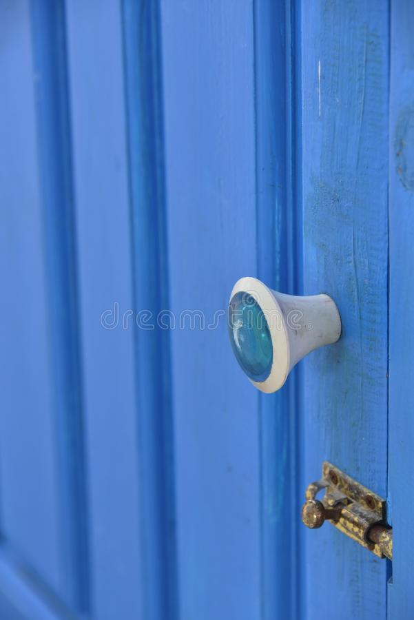 Handle on a blue door. White handle on a blue door ( open up door stock photo