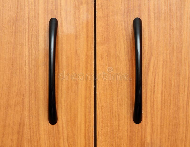 Handle on furniture. Close up of handle on wooden furniture royalty free stock photography