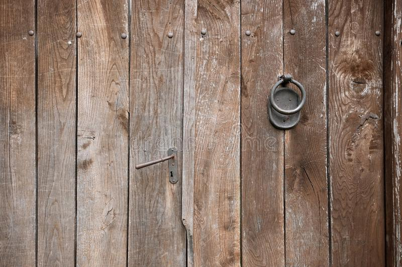 Handle And Knocker Door, Serbia. Handle and knocker on weathered wooden door, Serbia royalty free stock images