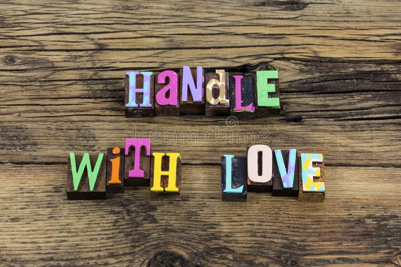 Handle with love life romance couple respect typography phrase. Letterpress greeting relationship protect care kindness kind stock images
