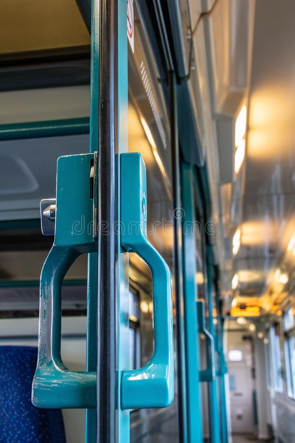The handle in open door of coupe in wagon. Close up. The interior of moving train with empty corridor stock images
