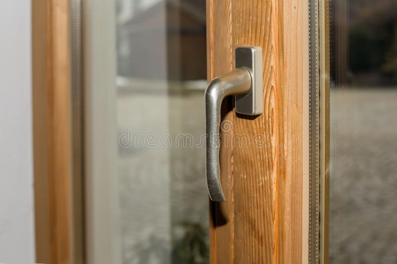 Handle of a patio door made of wood stock photography