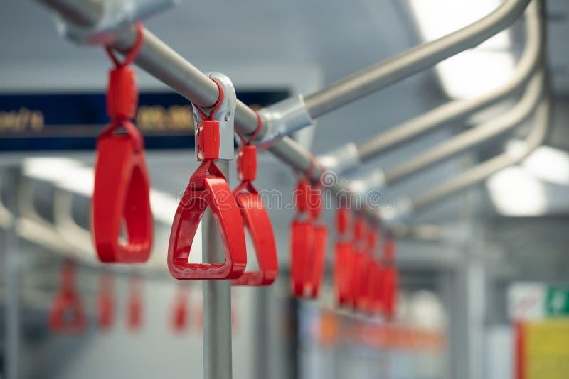 Handles for standing passenger inside a bus stock photos