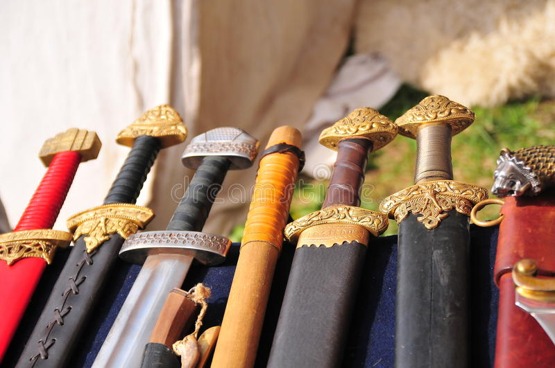 Handles of swords. Lying in a sheath on a table royalty free stock photo