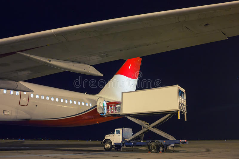 Handling food on the plane. At night royalty free stock photos