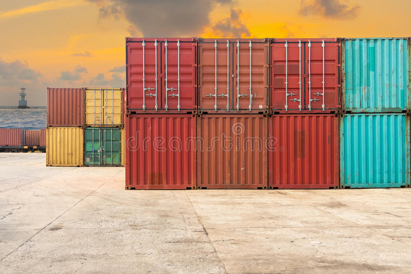 Handling stack of container shipping on twilight scene. Business transportation royalty free stock photos