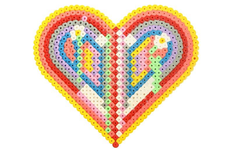 Handmade сердце applique сформировало сделанный из изолированных трубок на белизне стоковое фото rf