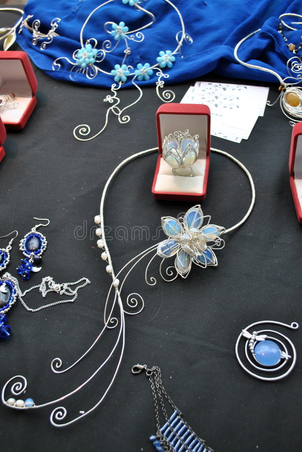 Handmade accessories. Necklace with a blue water lily stock photos