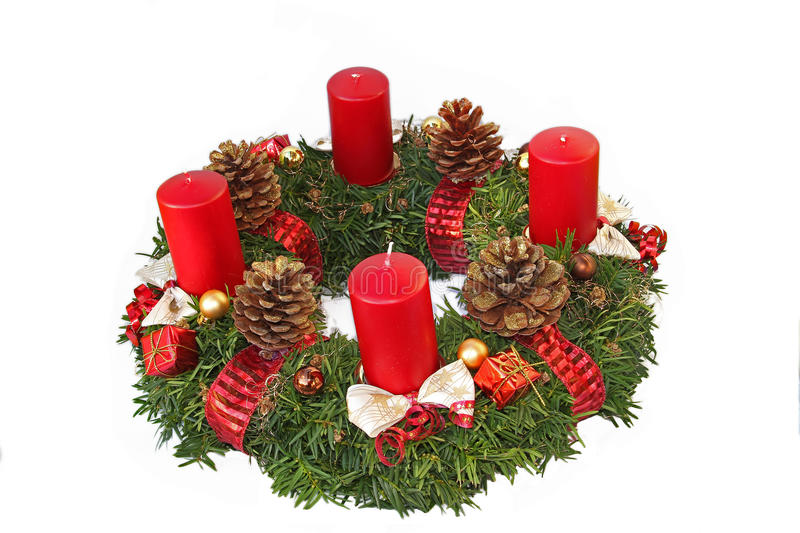 Handmade advent wreath with red ribbon and golden glittering con. Es, isolated on white stock photography