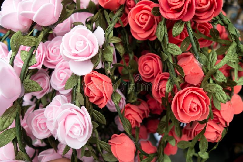 Handmade artificial roses for wreaths on Octoberfest in Munich, close-up. Handmade artificial roses for wreaths on Octoberfest in Munich, close-up royalty free stock image