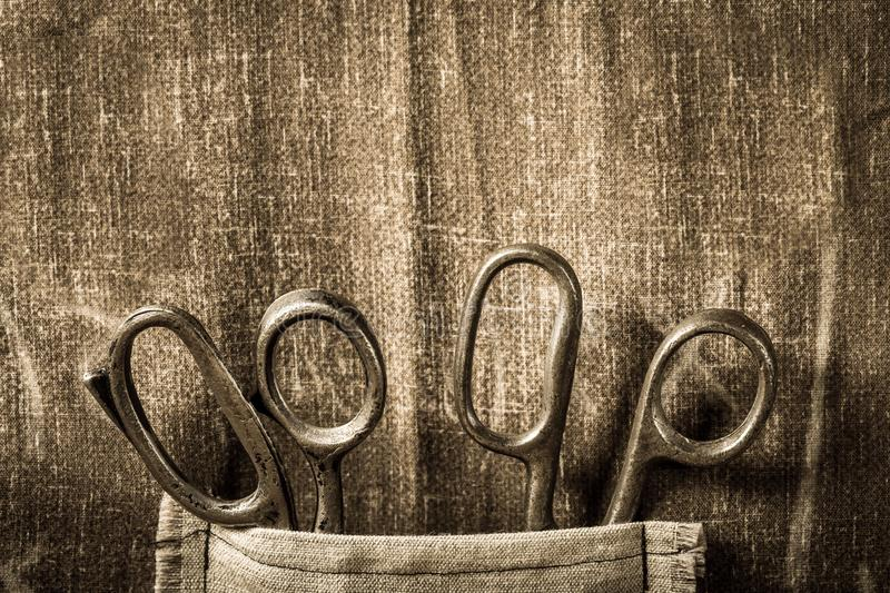 Handmade background with scissors in vintage tailor workshop stock photos