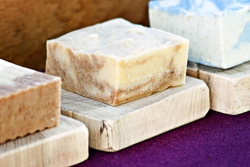 Handmade Bar of Soap. On wooden slab royalty free stock image