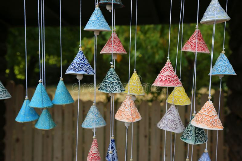 Handmade bells. Colorful handmade bells - crafts made by artisans hand stock photos