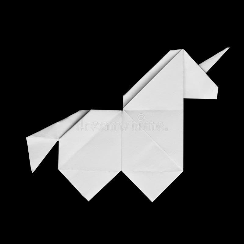 Handmade biała origami jednorożec na czarnym tle odizolowywającym fotografia royalty free
