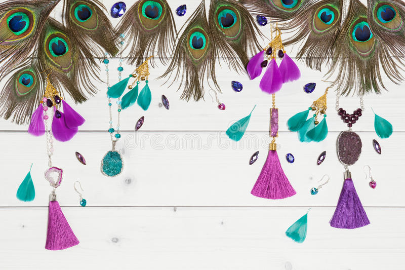 Handmade bijouterie with gems and feathers stock photos