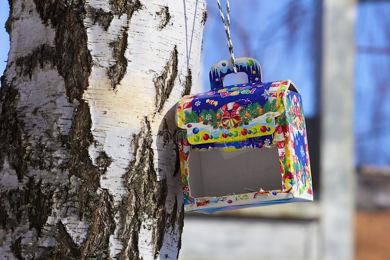 Handmade bird feeder in winter stock images