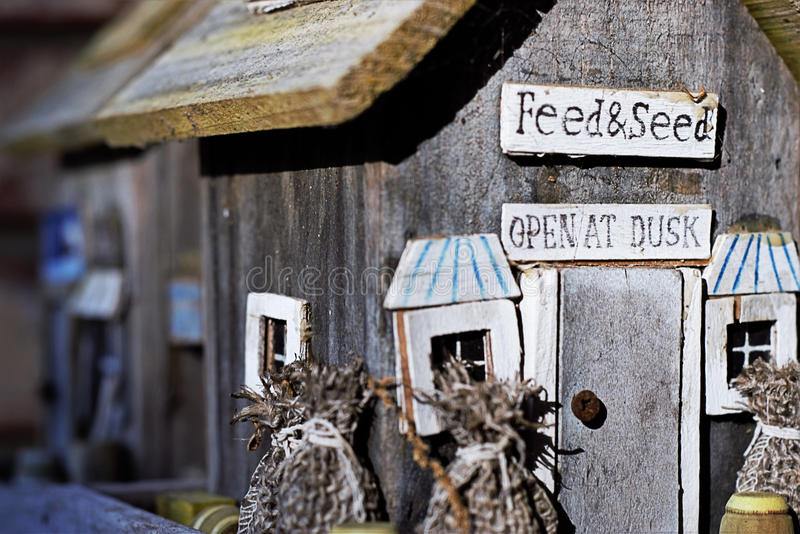 Handmade Bird Feeders. Unique hand-crafted bird feeders made of salvaged and recycled materials in the heartland of America stock photo
