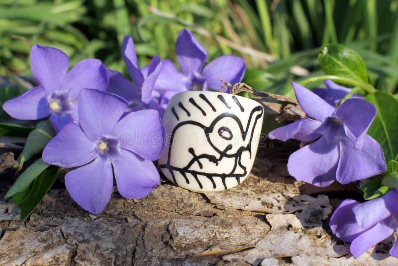 Handmade bone ring on the nature background. Handmade bone ring with wood violet in spring on the nature background royalty free stock photo
