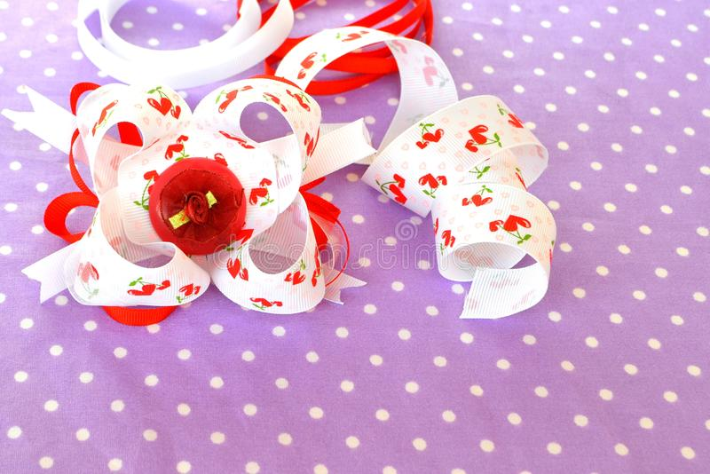 Handmade bow of ribbon, children hair accessory. Handmade bow of ribbon. Children hair accessory. Homemade bow of ribbon. Kids hair accessory stock photo