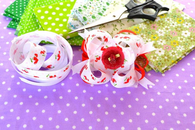 Handmade bow of ribbon, children hair accessory, ribbon set, scissors, cloth set. Handmade crafts. Ribbons bow crafts. Handmade bow idea. Original handmade royalty free stock photo