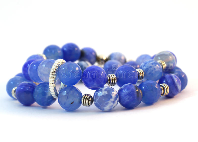 Handmade bracelet of blue beads royalty free stock photos