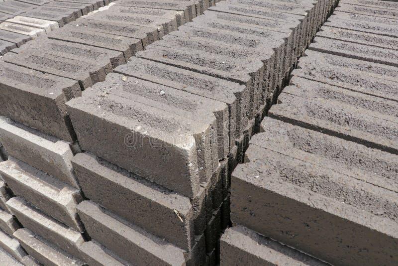 Handmade bricks made of black volcanic sand, water and cement. Manual production on Bali island, Indonesia. Process of sun-drying. Handmade bricks made of black royalty free stock photos