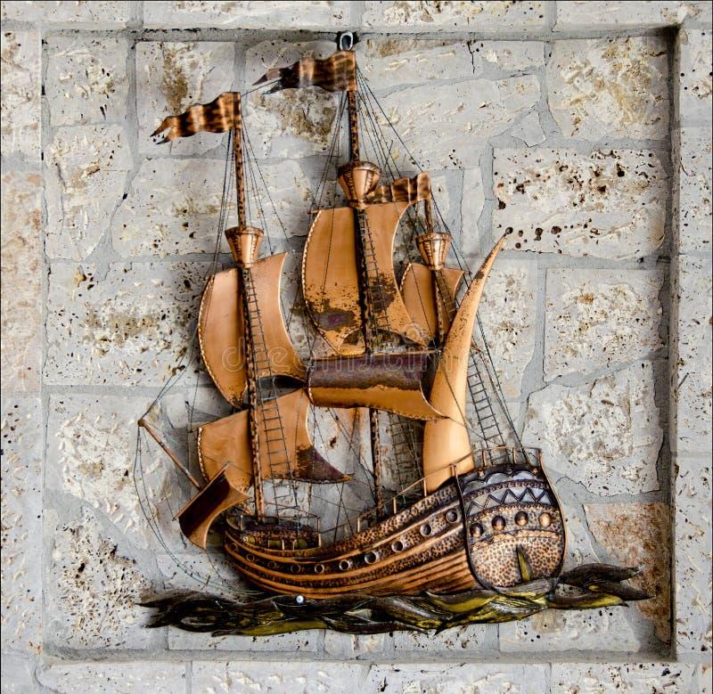Handmade bronze ship and stones stock image