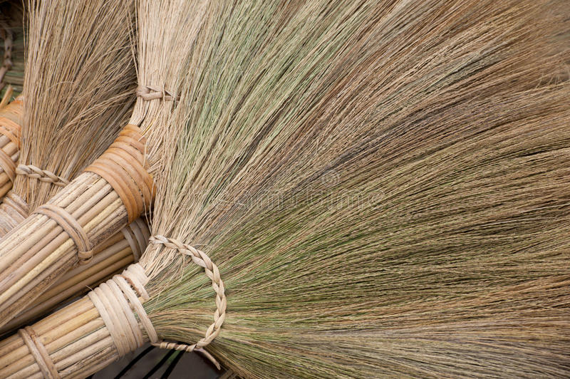 Handmade brooms. A pile of vietnamese brooms stock image