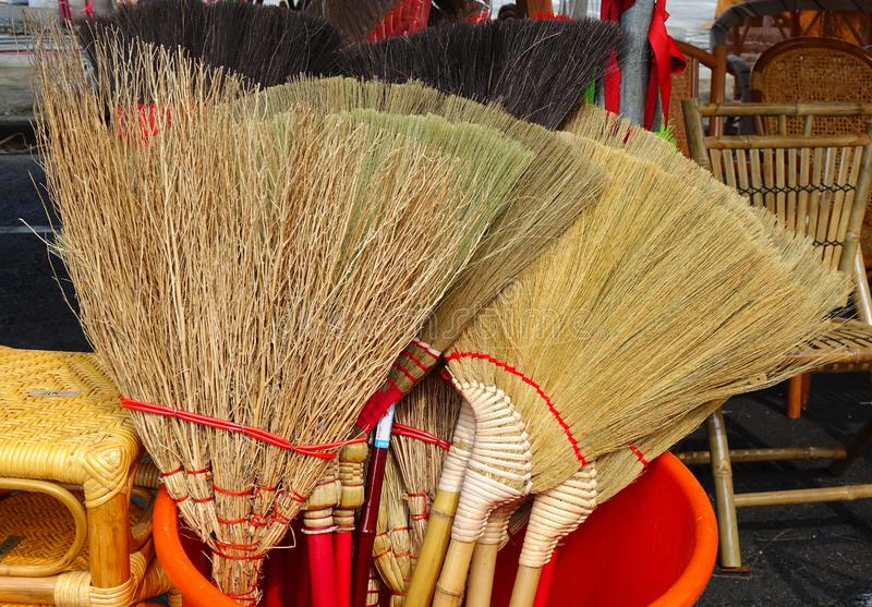 Handmade Brooms Made From Bamboo Branches royalty free stock images