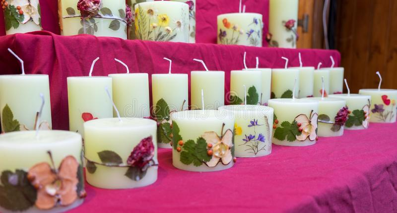 Handmade candles with fruit slices and flowers stock photos