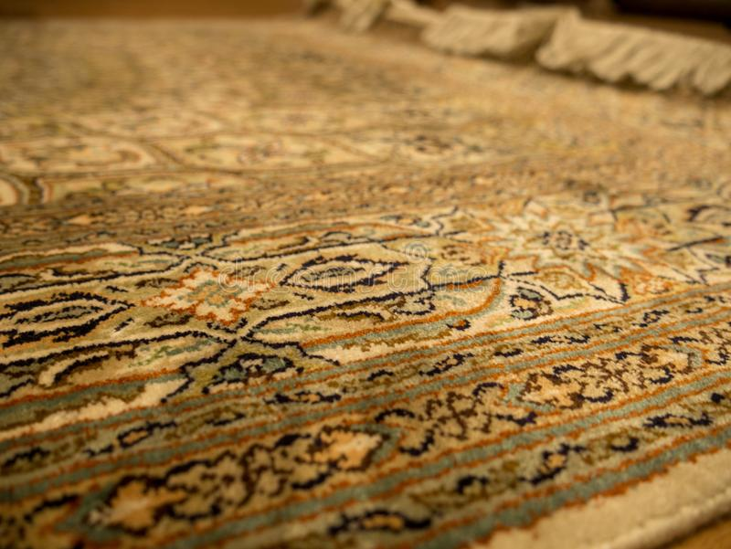 Handmade carpet. India worker craftsmanship royalty free stock photography