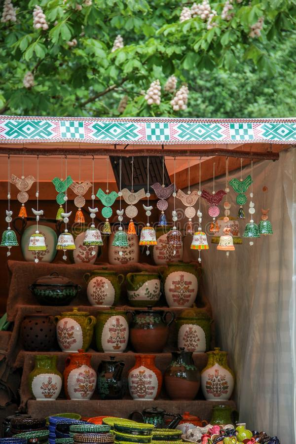 Handmade ceramic bells and some pots in the background royalty free stock photography