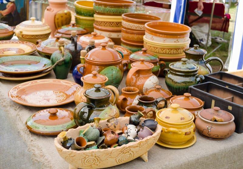 Handmade ceramic clay ware souvenirs street market. Rustic handmade ceramic clay brown terracotta ware souvenirs at street handicraft market stock images
