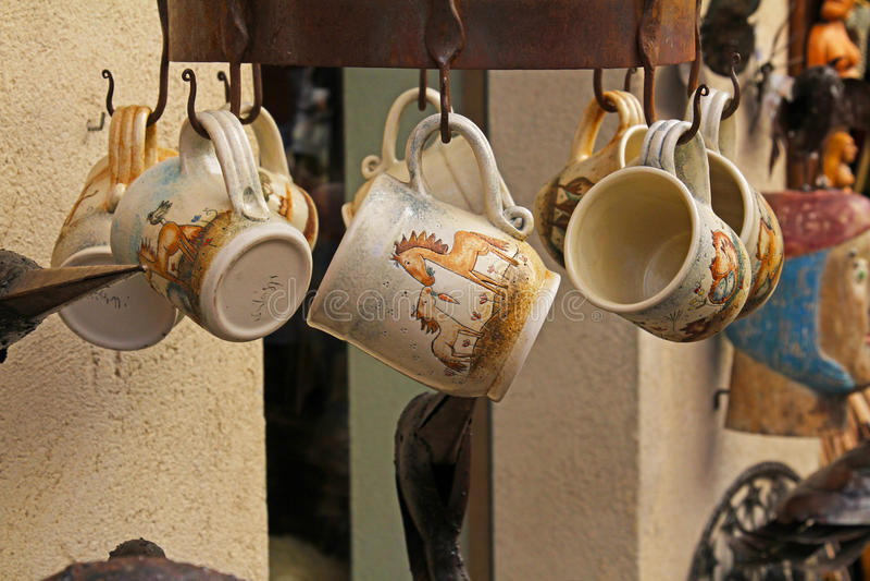 Handmade ceramic mugs on street market in Besalu. Besalu, Spain - September 09, 2014: Handmade ceramic mugs on street market in Besalu royalty free stock photo
