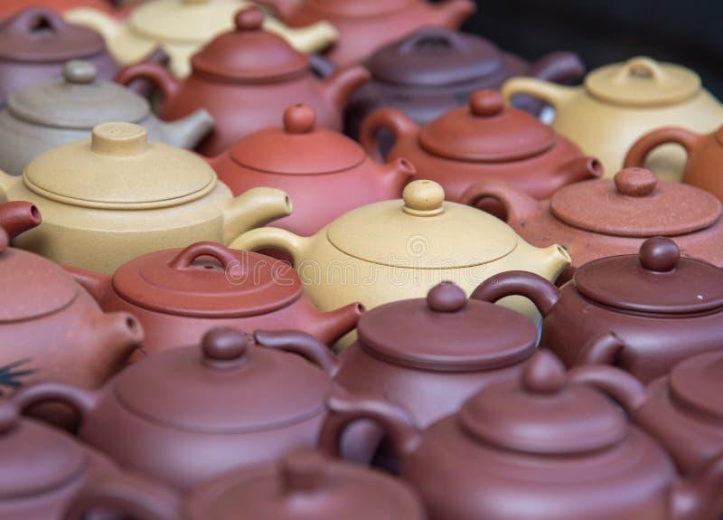 Handmade ceramic teapots for sale on am amtique market. Beautiful handmade ceramic teapots for sale on am amtique market royalty free stock photo