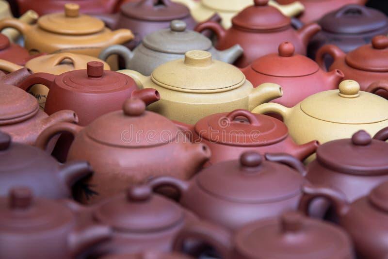 Handmade ceramic teapots for sale on am amtique market. Beautiful handmade ceramic teapots for sale on am amtique market royalty free stock photos