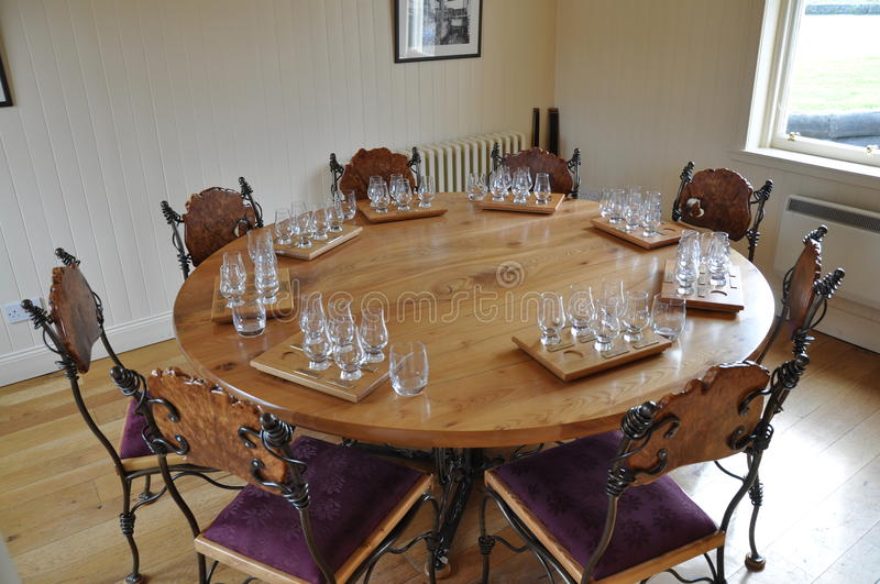Handmade chairs and round dining room table with degustation sets. At The Balvenie distillery in Dufftown, Scotland (near the town of Kirkwall , 2011 stock photos
