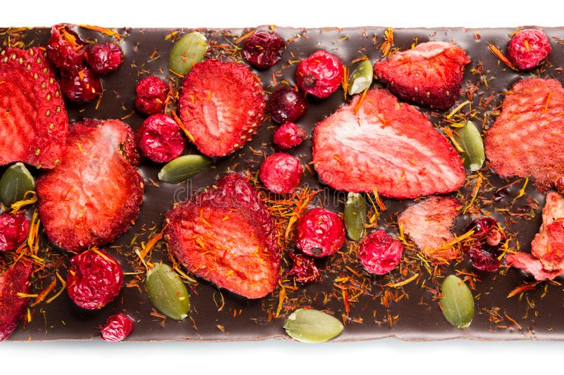 Handmade chocolate bars with dried cranberries, strawberries, nuts. Dark and milk chocolate mix, assortment. stock photography