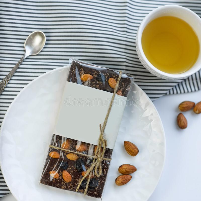 Handmade chocolate candies with nuts. On the table royalty free stock images
