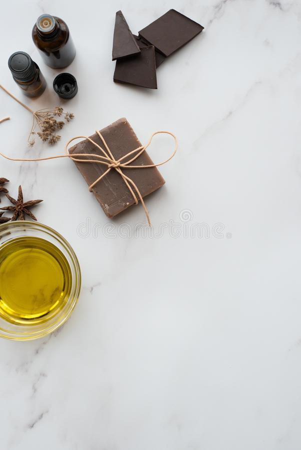 Handmade chocolate soap with olive oil and star anise vertical image. Handmade chocolate soap with olive oil and star anise on white surface, vertical image royalty free stock images